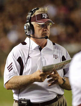 Texas A&M coach Mike Sherman watches from the sidelines against Stephen F. Austin on Sept. 4.