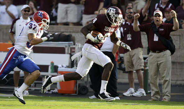 Texas A&M's Jeff Fuller (8) runs for a first down after a reception as Louisiana Tech's C.J. Broades gives chase in the first quarter on Sept. 11. Fuller caught 10 passes for 160 yards and a TD in the victory. The TD tied the school record for career receiving TDs at 19. He has 14 catches for 207 yards and three TDs on the season.