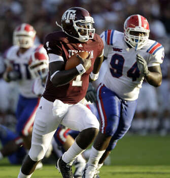 Texas A&M quarterback Jerrod Johnson rushes for a first down as Louisiana Tech's Ramone Randle (94) chases him on Sept. 11. Johnson rushed for 50 yards to go with 349 yards and four TDs passing the victory.