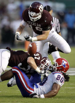 Texas A&M's Michael Hodges, a senior from O'Connor, and Kyle Mangan (18) break up a pass intended for Louisiana Tech's Eric Harper in the second quarter on Sept. 11. Hodges, a linebacker, made six tackles, an interception and a sack in the win.