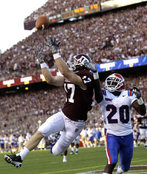 Texas A&M receiver Ryan Tannehill  catches a 10-yard touchdown pass as Louisiana Tech's Jamel Johnson (20) defends during the second quarter on Sept. 11, 2010. The junior caught three passes for 32 yards.