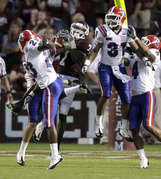 Texas A&M's Uzoma Nwachukwu somehow pulls down a 44-yard touchdown pass as Louisiana Tech's Ryan Williams (23), C.J. Broades, left, Chad Boyd (31) and Tank Calais (4) defend on the last play of the second quarter on Sept. 11. Nwachukwu added a 1-yard TD catch in the fourth quarter, giving him TDs on both receptions in the game.