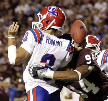 Louisiana Tech quarterback Tarik Hakmi has the ball knocked out by Texas A&M defensive tackle Damontre Moore in the end zone in the third quarter on Sept. 11. The  Bulldogs recovered the ball on the play. It was a sloppy game, with Tech losing two of seven fumbles and A&M losing four of five.