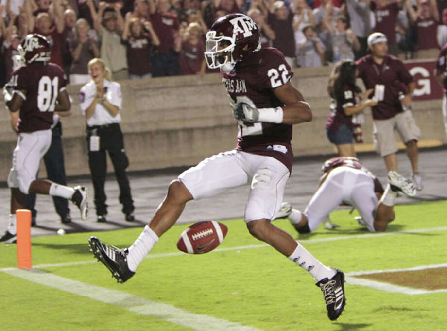 Texas A&M cornerback Dustin Harris celebrates after returning a punt for a touchdown in the third quarter against Louisiana Tech on Sept. 11. The sophomore had an interception return for a TD in the season opener against Stephen F. Austin. / © 2010 Houston Chronicle