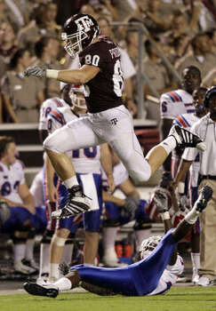 Texas A&M tight end Hutson Prioleau leaps over Louisiana Tech's Ryan Williams on a reception that went for a first down in the fourth quarter on Sept. 11. It was the 6-foot-4 freshman's first career catch and he gained 18 yards.