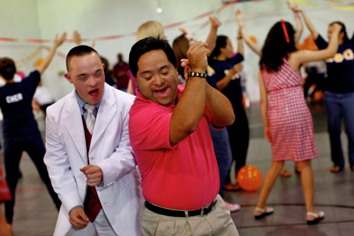 Kyle Butts (left) and Michael Benavidez dance during the Eva's Heroes Fall into Fall Dance on Sept. 14 at the Pam Stephens Center in San Antonio.