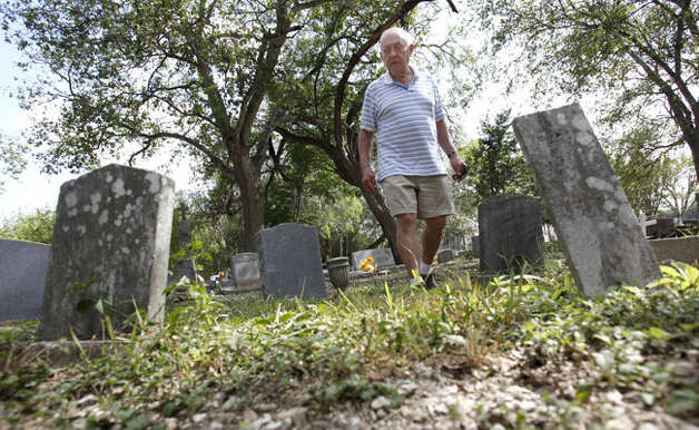 Louis Stoltz, visiting from New York, hunts for his grandparents' graves in the cemetery near Mission San Juan.
