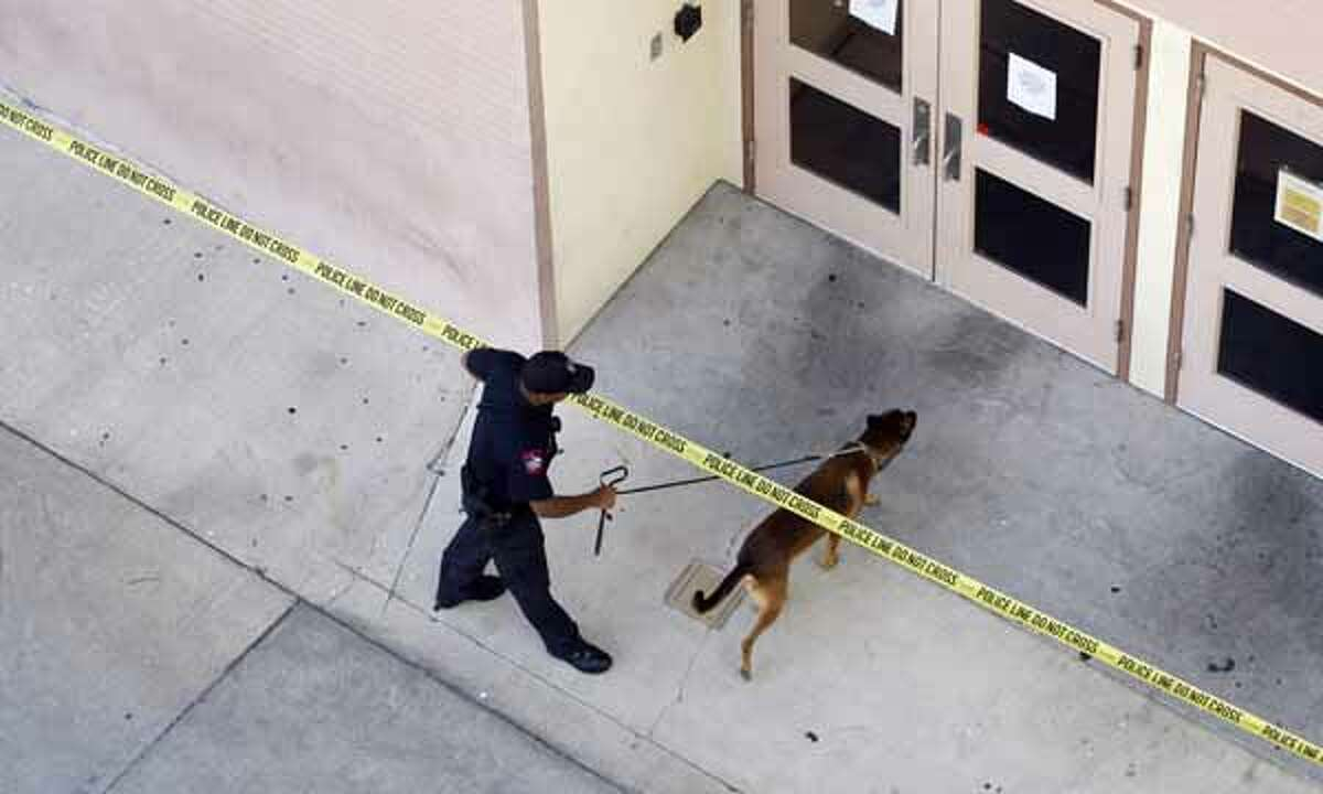 A man shot and killed himself on the sixth floor of a University of Texas at Austin library this morning, leading authorities to lock down the campus and school officials to cancel classes for the day. Police use a K-9 to search the University of Texas campus.