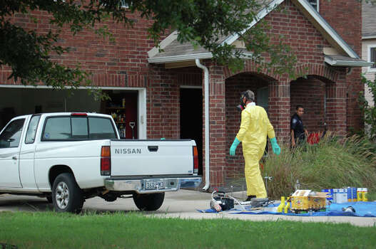 Oct. 28, 2010: San Antonio police remove chemicals from a Universal City home on Monday after busting a methamphetamine lab and hydroponic pot growing operation. Police arrested two men.