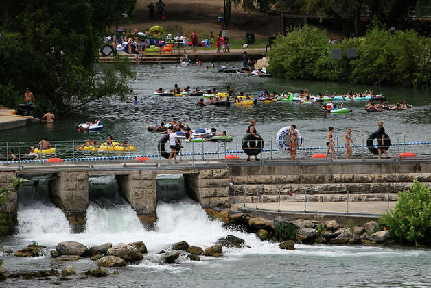Prince Solms Park and the Comal River Tube Chute was a bevy of activity on Labor Day in New Braunfels, Texas on Monday, Sept. 6, 2010. / San Antonio Express-News