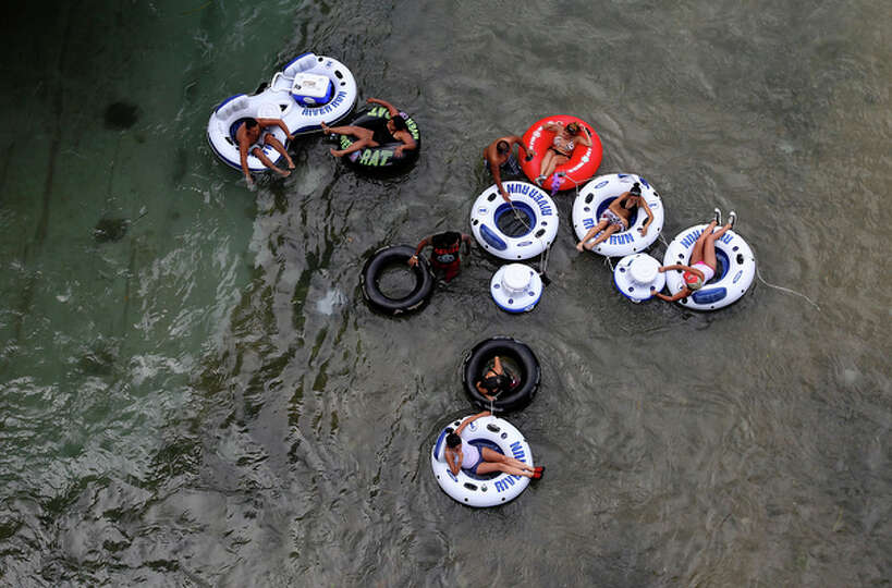 A group floats along the Comal River in Prince Solms Park on Labor Day in New Braunfels, Texas.