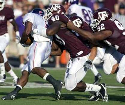 Texas A&M senior linebacker Von Miller, shown against Stephen F. Austin, led the nation in sacks last year but passed on the NFL.