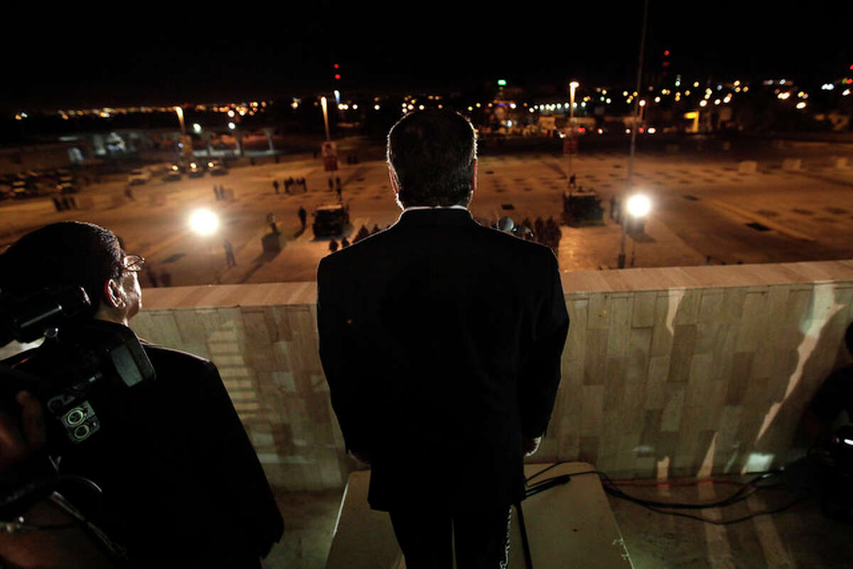 Juarez Mayor Jose Reyes Ferriz, presides over an empty city hall parking lot during the celebration of