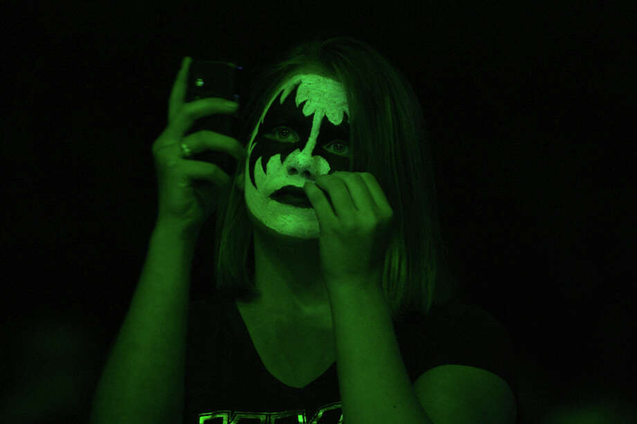 A fan takes a photo as one of the opening bands performs before the KISS concert at the AT&T Center, September 19, 2010. / special to the Express-News