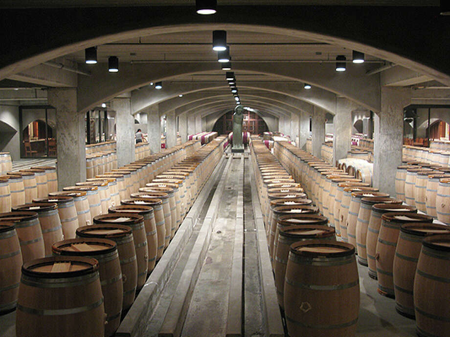 The tour stopped in the first-year barrel fermentation room at Robert Mondavi Winery.