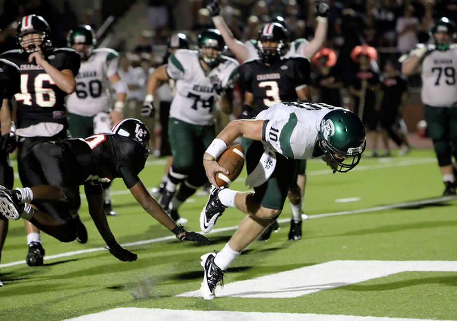 Reagan quarterback Trevor Knight (10) then scored on a keeper in the first overtime to tie the game and force a second overtime against Churchill, 28-28. / San Antonio Express-News