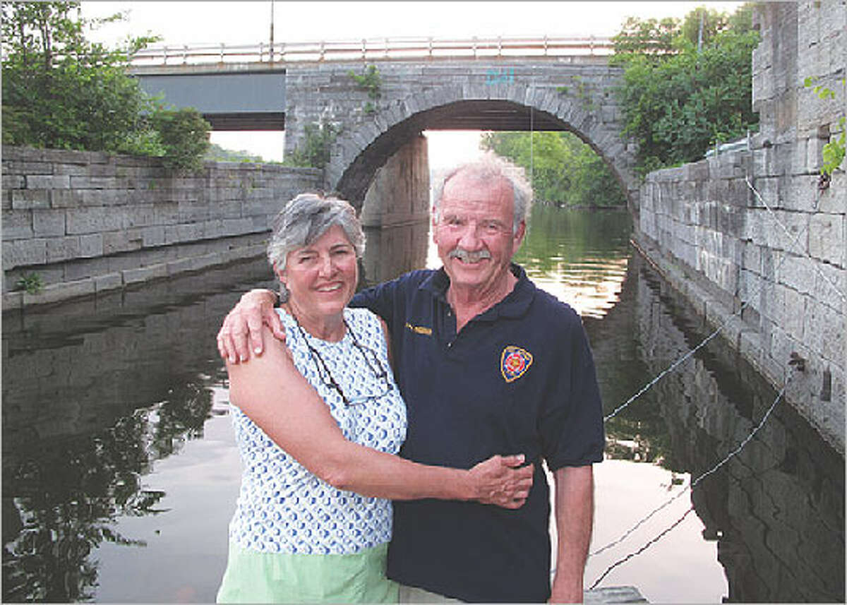 Linda and Phil Hardberger pause along the Erie Canal in Schenectady, N.Y.