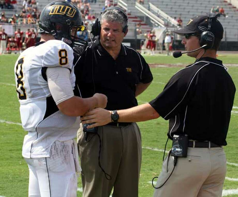 Quarterback Mitchell Bunger and head coach Danny Padron (center) helped snap a 14-game TLU losing streak with a 17-14 victory against East Texas Baptist last week.