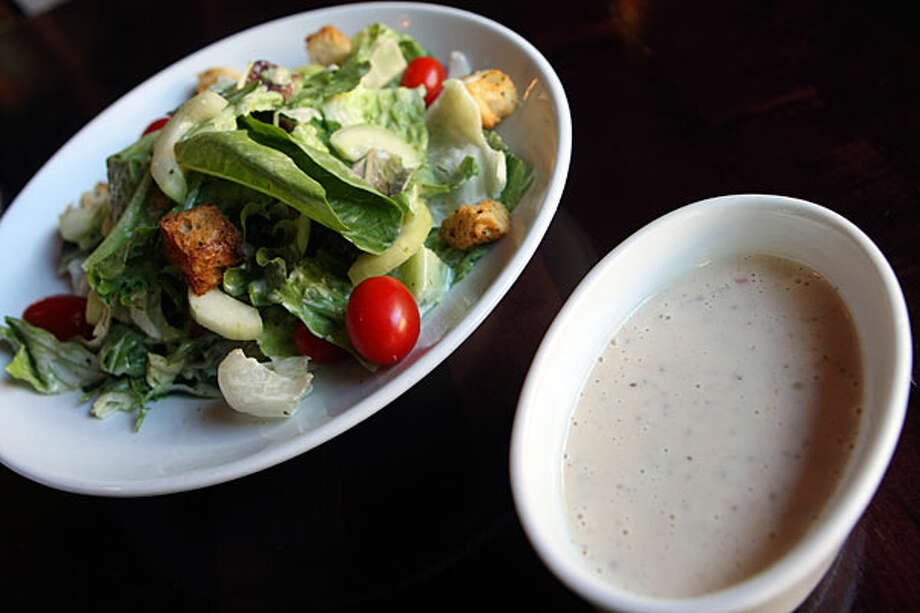 A Paesanos customer thinks the restaurant?s dressing with its house salad is delicious.