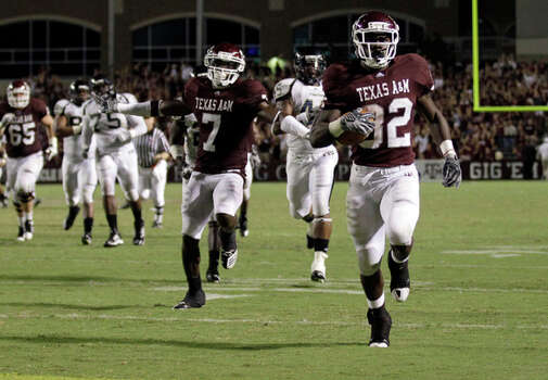 Texas A&M running back Cyrus Gray (32) breaks away for a go-ahead 40-yard touchdown run with a little more than four minutes left on Sept. 18. The score broke a 20-20 tie, giving A&M its first lead in a 27-20 victory. / AP