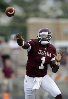 Texas A&M quarterback Jerrod Johnson throws a pass against Florida International during the first quarter on Sept. 18. Johnson had one of his worst, if not the worst, performances of his career. He completed 11 of 31 passes for 194 yards with four interceptions and he was sacked six times. He also had a fumble. / AP