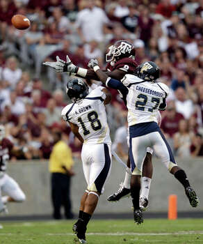 Florida International's Kreg Brown (18) and Jose Cheeseborough (27) break up a pass intended for Texas A&M's Jeff Fuller (8) during the second quarter on Sept. 18. It was one of 20 passes thrown by Jerrod Johnson that weren't caught by an A&M receiver. / AP