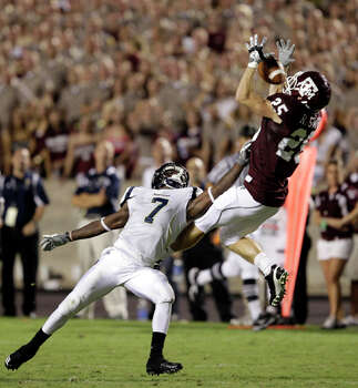 Texas A&M's Ryan Swope (25) reaches for a pass as Florida International's Anthony Gaitor (7) defends during the third quarter on Sept. 18. Swope caught three passes for 46 yards in the game. / AP