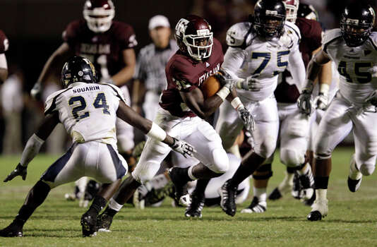 Texas A&M running back Cyrus Gray (32) breaks away from Florida International's Emmanuel Souarin (24) for the game-winning 40-yard touchdown run near the end of the fourth quarter on Sept. 18. The Aggies won 27-20. / AP
