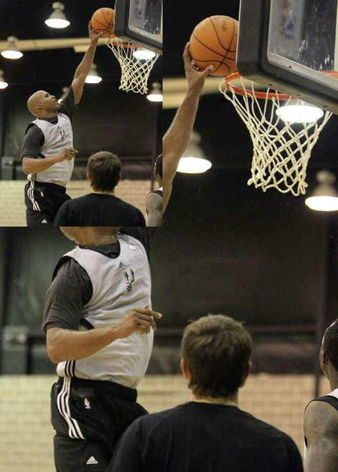 Richard Jefferson goes up for a dunk as the San Antonio Spurs hold their first practice of the 2010-2011 season at their practice facility on Tuesday, Sept. 28, 2010. Kin Man Hui/kmhui@express-news.net