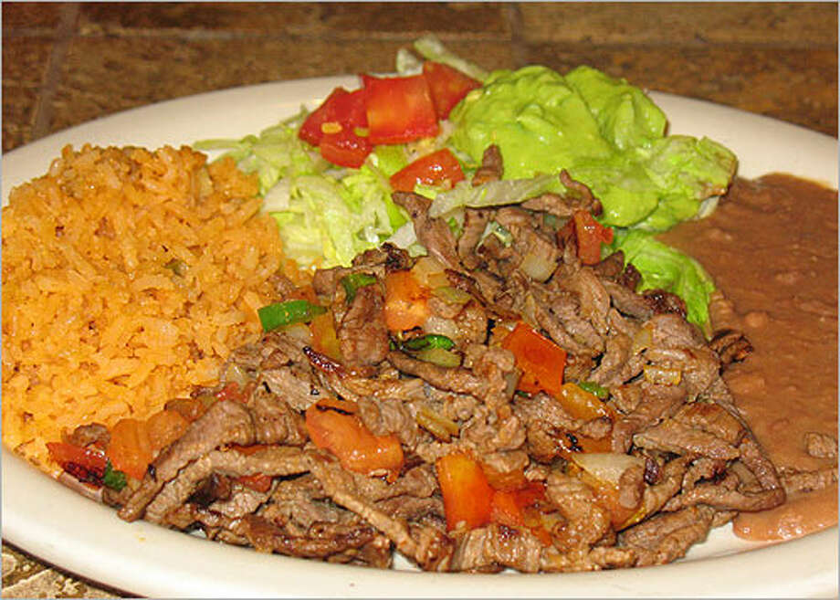 Carne a la Mexicana from Hacienda Patron Mexican Grill & Seafood is served with  rice, refried beans and a guacamole salad.