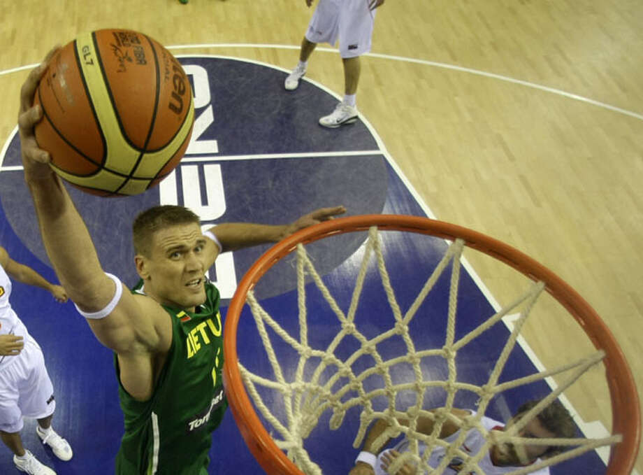 Lithuania's Robertas Javtokas slams a ball during a 76-73 win over Spain on Aug. 31. The 6-foot-11 Javtokas, who had eight rebounds in the win, has been playing overseas since the Spurs drafted him 56th overall in 2001. / AP