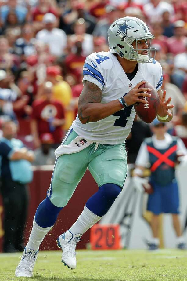 Dallas Cowboys quarterback Dak Prescott (4) scrambles with the ball during the second half of an NFL football game against the Washington Redskins in Landover, Md., Sunday, Sept. 18, 2016. (AP Photo/Alex Brandon) Photo: Alex Brandon, Associated Press / Copyright 2016 The Associated Press. All rights reserved.