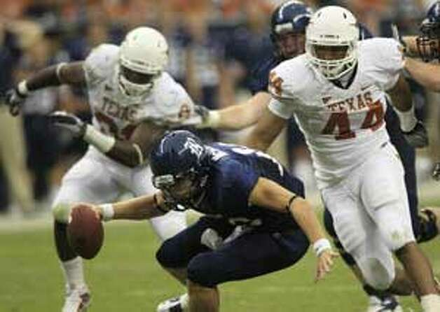 Texas' Jackson Jeffcoat (right) pursues Rice quarterback Taylor McHargue during UT's 34-17 win on Sept. 4.