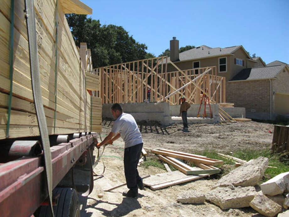 Evidence of  the housing  rebound in Boerne can be seen as Jose Cabral of Hart Components delivers a  load of prefabricated framing lumber to a home site.
