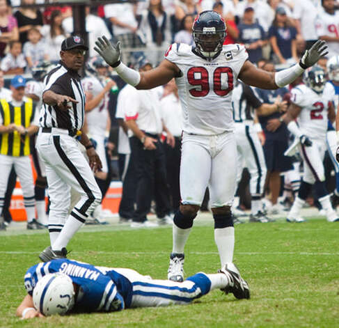 Colts quarterback Peyton Manning lies face down as Texans defensive end Mario Williams denies involvement.