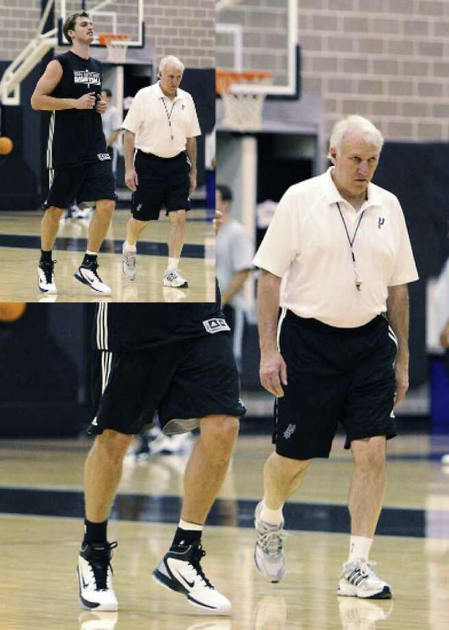 Tiago Splitter (left) runs past coach Gregg Popovich as the Spurs hold their first practice of the season at their practice facility on Tuesday.