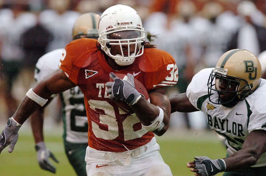 Texas running back Cedric Benson was sixth in Heisman voting in 2004, when he capped his career in Austin with 1,834 yards and 19 TDs. He also caught 22 passes for 179 yards and another TD as the Longhorns finished 11-1 after a victory over Michigan at the Rose Bowl. / SAN ANTONIO EXPRESS-NEWS