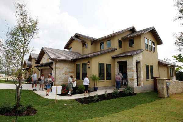 Builder Brohn Homes? entry at 20102 Bella Glade features Italian country design with hand-scraped wood floors on about 2,858 square feet. The home won for best furnishings.