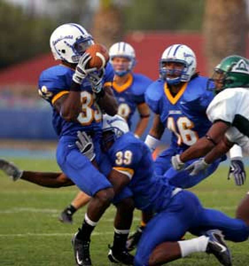 Players such as Jay's Derrick Thomas (33) battled through rough times at A&M-Kingsville.