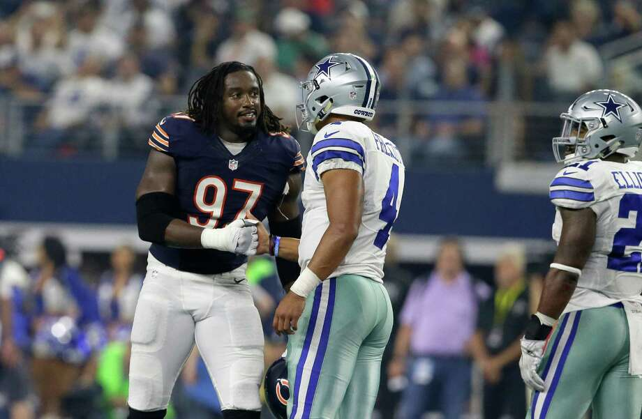 Chicago Bears' Willie Young (97) greets Dallas Cowboys quarterback Dak Prescott (4) as Ezekiel Elliott, right, watches in the second half of an NFL football game, Sunday, Sept. 25, 2016, in Arlington, Texas. (AP Photo/LM Otero) Photo: LM Otero, Associated Press / AP
