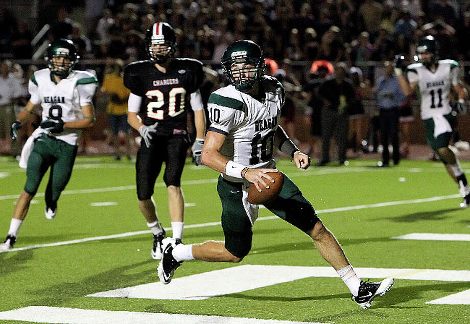 Reagan quarterback Trevor Knight runs in for the go-ahead touchdown in the second overtime against Churchill at Heroes Stadium on Friday night. / San Antonio Express-News