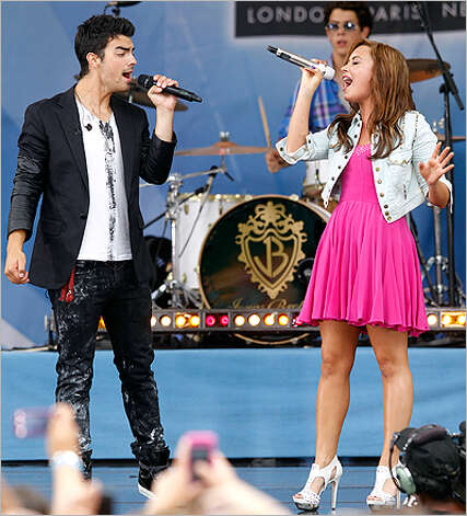 "Joe Jonas and Demi Lovato sing during ""Good Morning America"" last month."