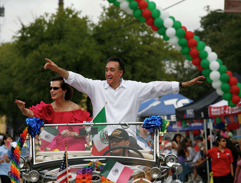 San Antonio District 1 Councilwoman Mary Alice Cisneros and former Mayor and HUD Sectretary Henry Cisneros wave to the crowd during the Guadalupe Avenue Association's 16 de Septiembre parade and festival at Guadalupe Plaza in San Antonio. / THE SAN ANTONIO EXPRESS-NEWS