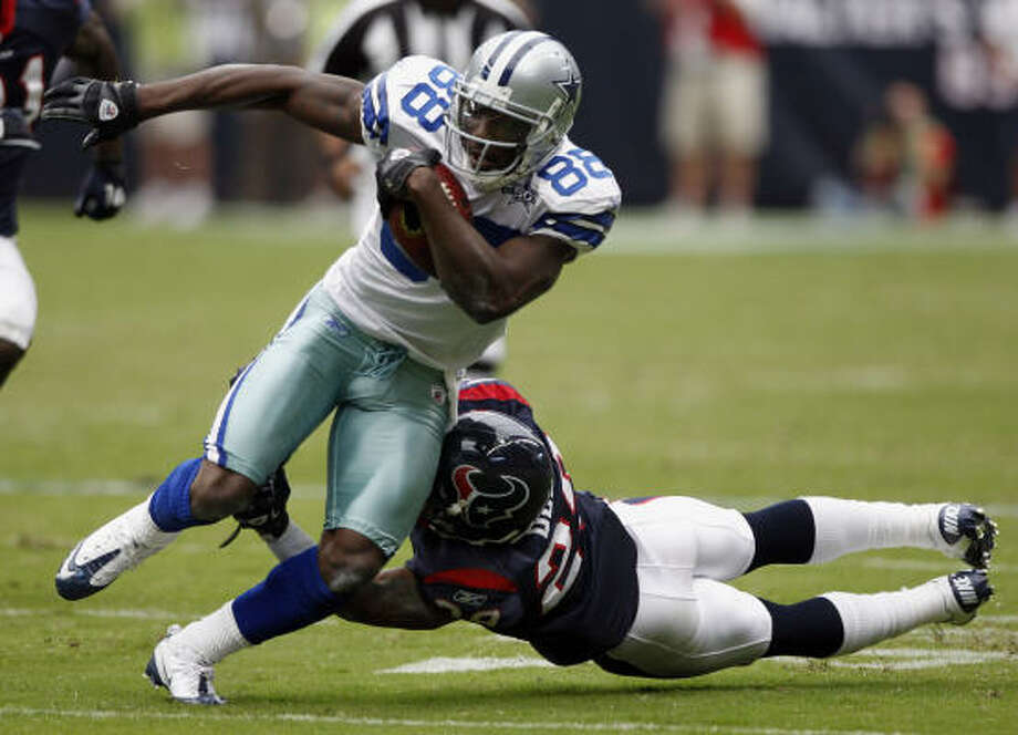 Cowboys wide receiver Dez Bryant pulls away from Texans cornerback Glover Quin on Sunday.