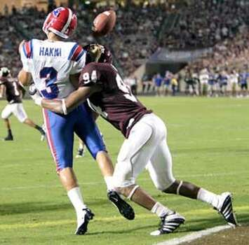 Aggies defensive tackle Damontre Moore knocks the ball from the grasp of Louisiana Tech quarterback Tarik Hakmi during the teams' Sept. 11 game.