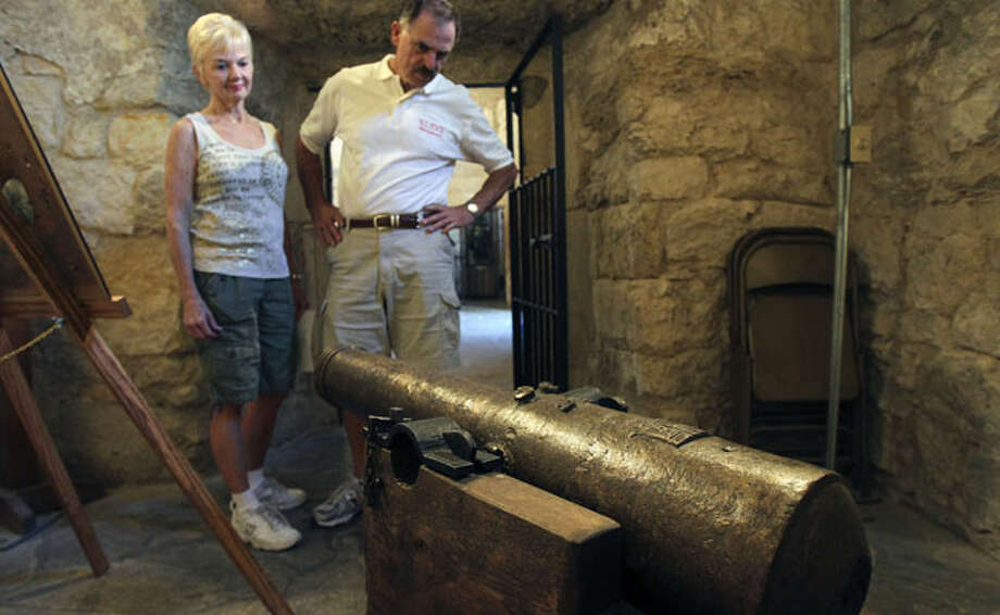 Betty and Boyd Grier of High Point, N.C., check out a cannon on display at the Alamo, where some believe it was used by the shrine's defenders. If true, it would be the only known bronze Spanish cannon recovered from the battle.