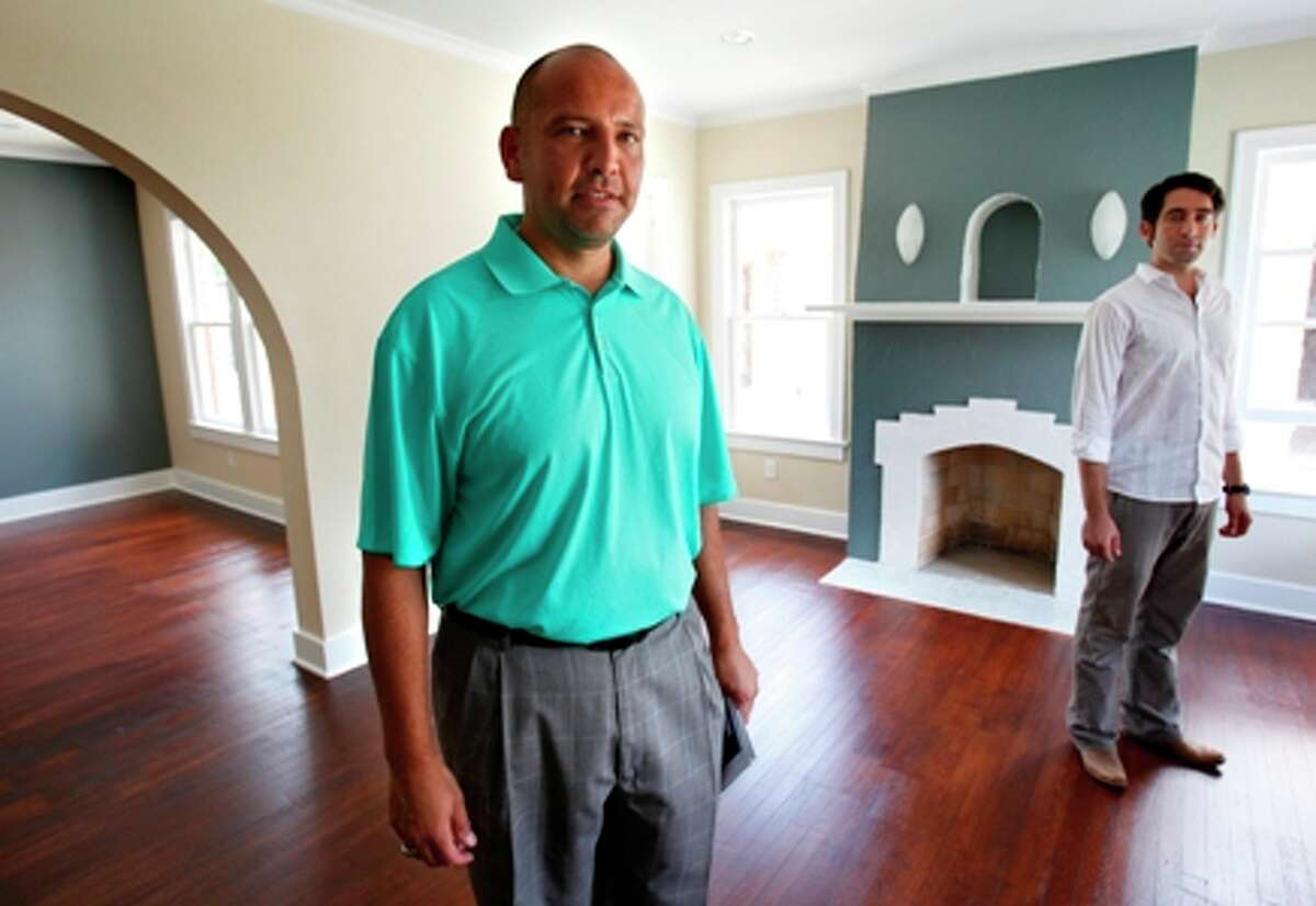 Former Mayor Ed Garza (left) and Sam Wayne, partners in Zane Garway, buy and flip houses in the Monticello Park/Jefferson area.