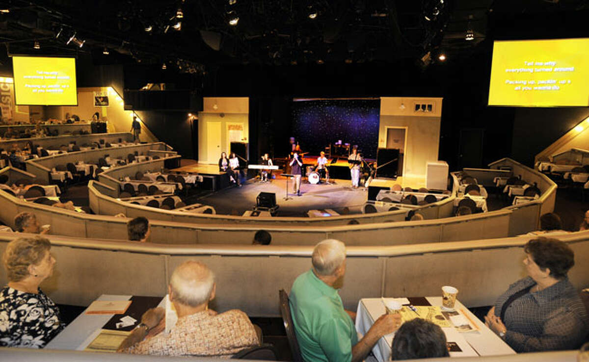 Worshippers listen to a rock band at the Garden, a contemporary service of St. Luke's United Methodist Church at a dinner theatre in Indianapolis.