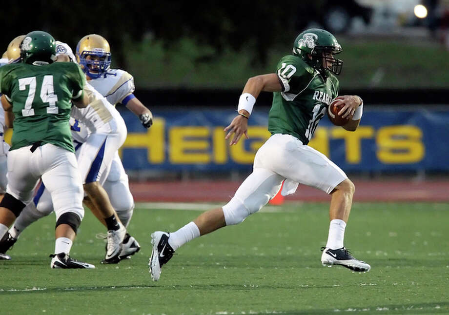 Reagan quarterback Trevor Knight (right) finds room to run against Alamo Heights. The Rattlers defeated the Mules, 23-6. / San Antonio Express-News
