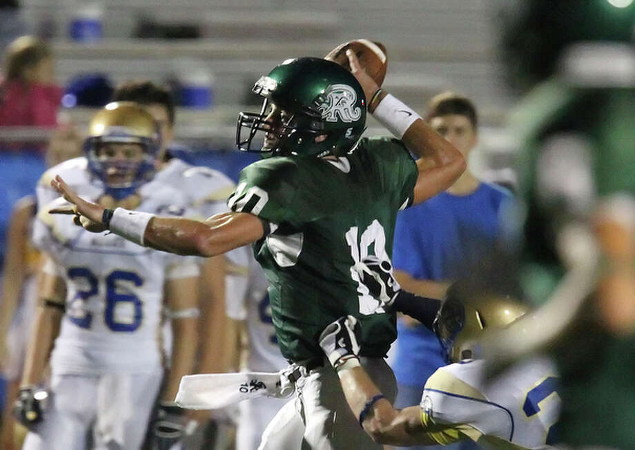 Reagan quarterback Trevor Knight attempts a pass under pressure. / San Antonio Express-News